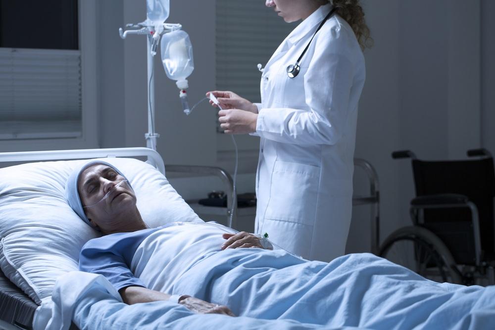 Nurse helping dying woman